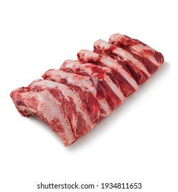 Close-up view of fresh raw Back Ribs cut in isolated white background