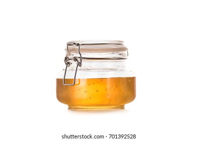 close-up view of fresh sweet honey in glass jar isolated on white