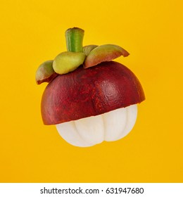 close-up view of fresh Thailand mangosteen isolated on yellow background.