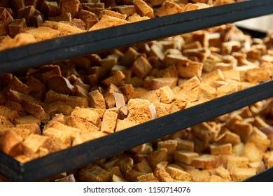 Close-up view of frying pan with fresh bread rusks