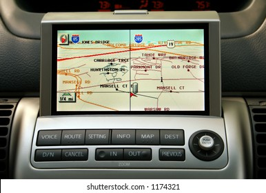 A close-up view of a GPS vehicle navigation system inside a car.