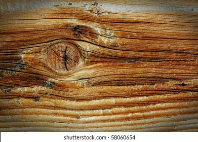 Closeup view of grainy wooden texture with knotted