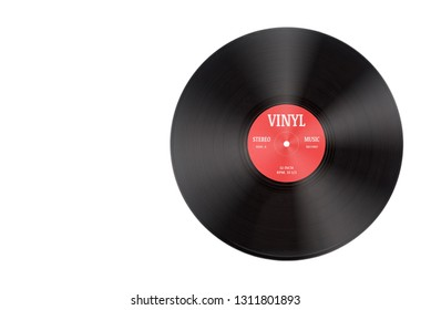 Closeup view of gramophone vinyl LP record or phonograph record with red label. Black musical long play album disc size 12 inch 33 rpm spiral groove. Stereo sound record. Isolated on white background.