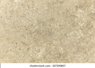 Closeup View of Ground Texture Consisting of Gray Sand and Small Stones