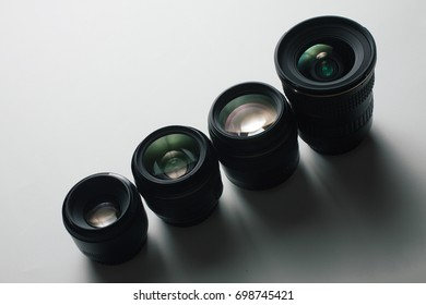 close-up view of a group of camera lenses on a white surface