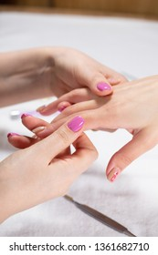 Closeup view of hands with manicure of young woman Nail treatment by a specialist in the salon Soft focus