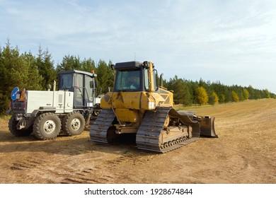 Close-Up View Of Heavy Bulldozer. Construction machinery. Bulldozer on the construction of a new road. Dedicated Construction machinery for handling bulk materials