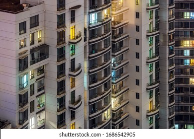 Closeup View of Highrise at Night Time. Colorful Illuminated Windows. Residential Buildings in Downtown Shanghai, China.