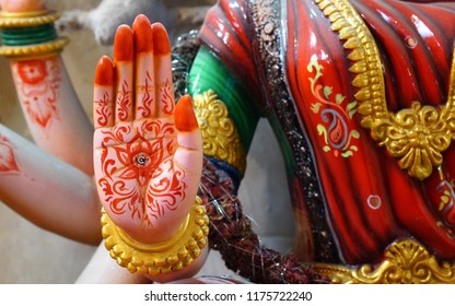 Closeup view of Hindu Goddess Durga idol,in blessing  pose with right hand made out of POP material,for worshiping in Dussera festival
