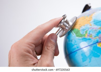 Close-up view of human hand with acoustic stethoscope examining globe