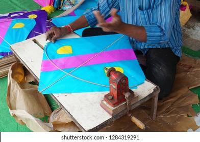 Closeup view of Indian man making Kite for use in Pongal or makara sankranti festival