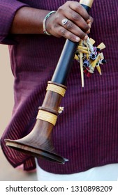 Closeup view of an Indian musician hold shenai or nada swaram wind blowing musical instruments, a tradtion iHindu marriages and religious functions