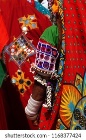 Closeup view of Indian nomadic tribal lambadi woman traditional  head dress,silvery jewelry and costume in Kajal Teej or Monsoon Festival  in Hyderabad,India