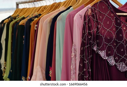 Closeup view of Indian woman fancy and fashion dress Hung on hangers in display of a retail shop