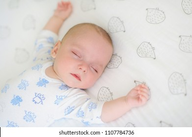 Closeup view of an innocent baby sleeping in bed. Nursery for children. Understanding your baby's sleep