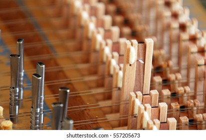 Close-up view of inside of harpsichord (shallow depth of focus)
