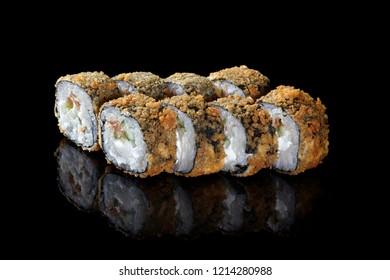 Closeup view of Japanese sushi shrimp tempura roll, isolated on black background.