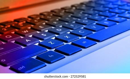 Closeup view of komputer (notebook) keyboard, colorized