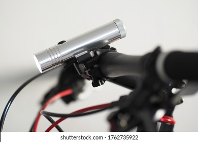 Close-up view. LED Flashlight on Bike Handlebar.