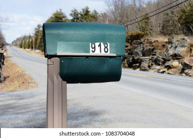 Closeup view of a mailbox at the side of the road.