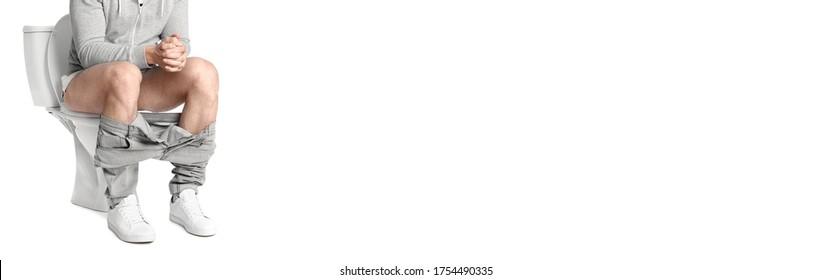 Closeup view of man sitting on toilet bowl, white background. Banner design