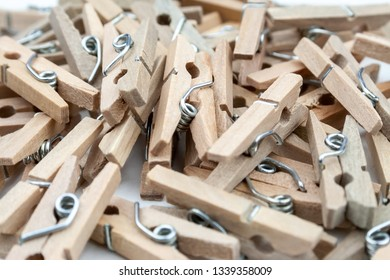 Closeup view of many wooden clothespins scattered on the table