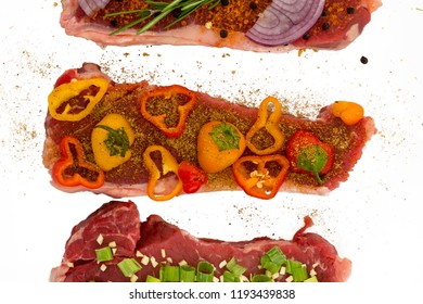 Closeup view of meats deliciously seasoned with colorful vegetables gochujang and black pepper, isolated on white