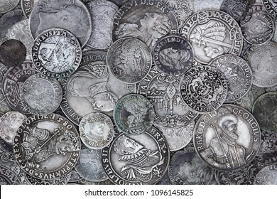 Closeup view of medieval European silver coins. Suitable for an abstract background.