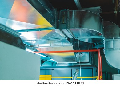 Close-up view of the modern big dimensions ductwork installed on the ceiling of the ventilation plant room