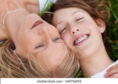 close-up view of mother and daughter lying close together