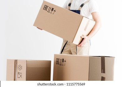 Close-up view of mover holding cardboard box isolated on white background. Concept o relocation into new house. Loader with boxes