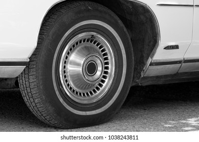 a closeup view of an old car tire in white and black