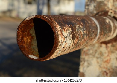 Closeup view of an old rusted pipe that is seperated at the end.
