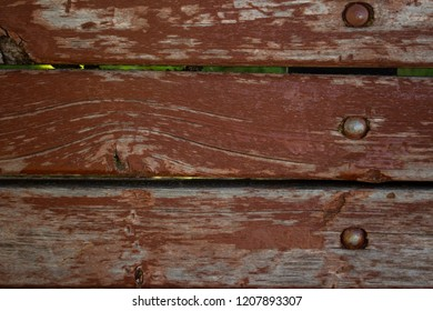 Close-up view of old worn wood painted red