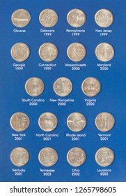 Close-up view of ollection of Quarter dollars (25 cents) coins in album - numismatic collection