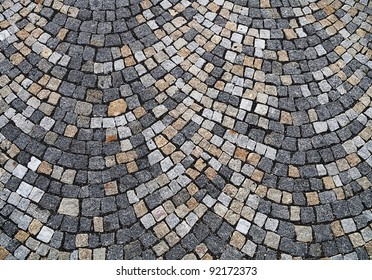 Closeup view on a cobblestone road - pattern - background