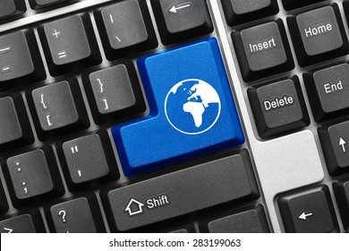 Close-up view on conceptual keyboard - Blue key with world symbol