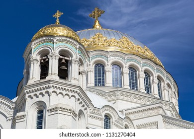 Close-up view on dome of Naval Cathedral of St. Nicholas (Nikolsky Marine Cathedral) with deep blue sky in Kronshtadt, Saint-Petersburg, Russia
