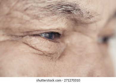 Close-up view on the eye of elderly human