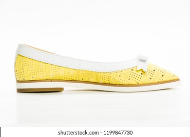 Close-up view on new fashionable elegant classic man and woman shoes and casual unisex shoes isolated on white background studio shooting. Qualitative and comfortable lifestyle clothing concept
