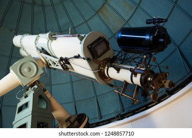 closeup view on oculars of large professional telescope located indoors