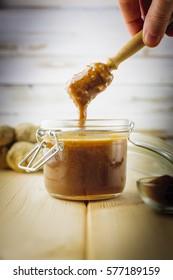 Closeup view on a pot of homemade ginger honey
