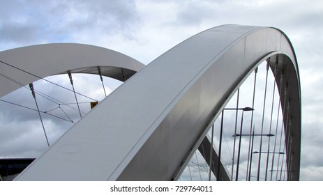 Close-up view on a suspension bridge round steel arch