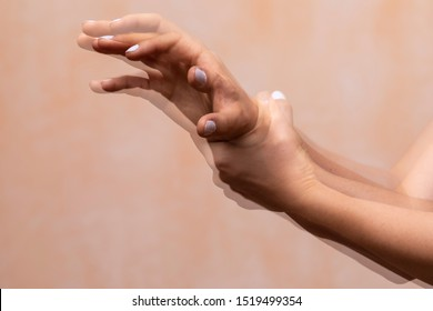 A closeup view on the violently shaking hands of a PD sufferer (Parkinson's disease), tremors of the wrist and hand joints are the main symptom of the disorder.