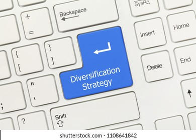 Close-up view on white conceptual keyboard - Diversification Strategy (blue key)