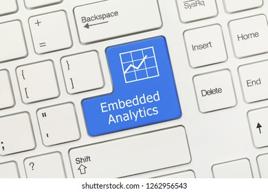 Close-up view on white conceptual keyboard - Embedded Analytics (blue key)