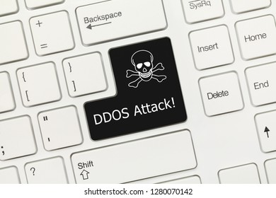 Close-up view on white conceptual keyboard - DDOS Attack (black key)