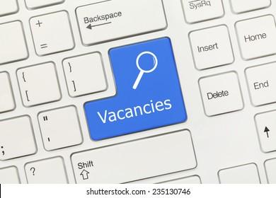 Close-up view on white conceptual keyboard - Vacancies (blue key)