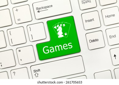 Close-up view on white conceptual keyboard - Games (green key)