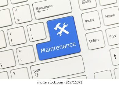 Close-up view on white conceptual keyboard - Maintenance (blue key)